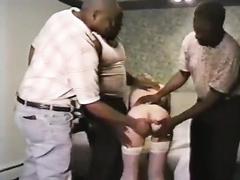Slim blonde woman serves several black cocks simultaneously